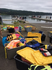 """Prepping for success. A bounty of life jackets in different sizes and styles to """"fit"""" everyone's needs."""